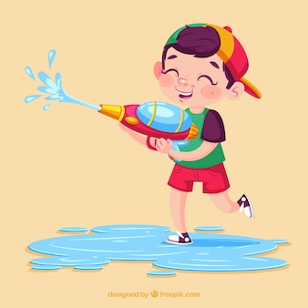 Bambino che gioca con pistola ad acqua colorata