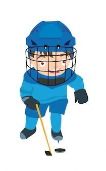 Bambino che gioca la competizione all'aperto di sport dell'hockey