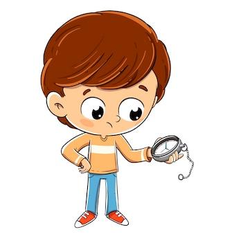 Bambino che guarda al momento su un orologio in attesa