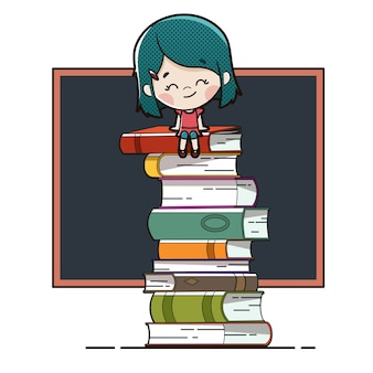 Bambino seduto su libri con una lavagna