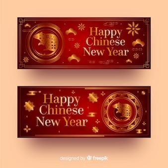Bandiere cinesi rosse e dorate di nuovo anno
