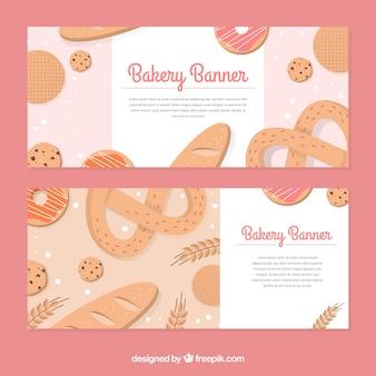 Bandiere del forno con dolci e pane in stile piatto