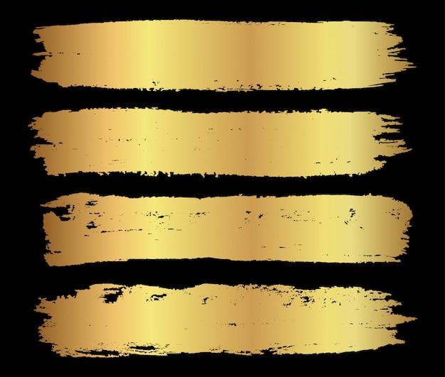 Bandiere dorate del tratto di pennello grunge