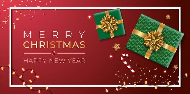 Banner di natale. sfondo design natalizio di ghirlanda di luci scintillanti, con confezione regalo realistica, stelle dorate e coriandoli glitter oro. poster di natale orizzontale, biglietti di auguri, intestazioni, sito web