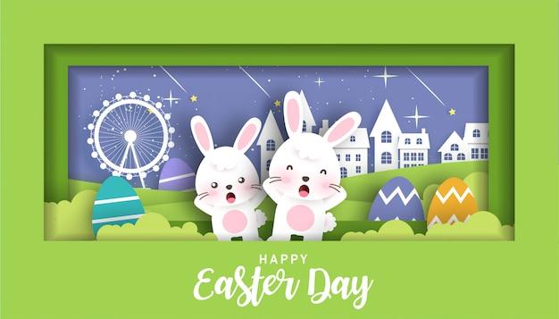 Banner di pasqua con coniglietti e uova di pasqua in carta tagliata e stile artigianale.