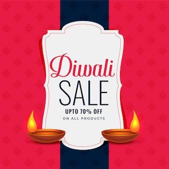 Banner di vendita alla moda diwali con due lampade diya