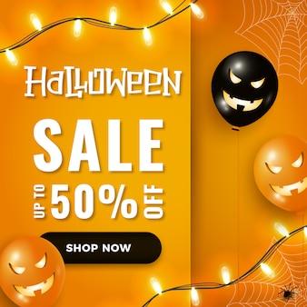 Banner di vendita di halloween con mongolfiere spaventose di halloween, luci ghirlanda su orange