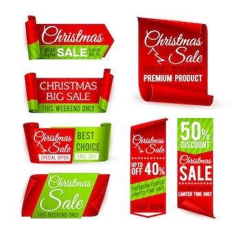 Banner di vendita di natale. i nastri di seta rossi con lo sconto di natale e la festa di natale di inverno offrono il testo. set vettoriale