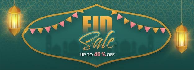 Banner di vendita eid con appeso illuminato lanterna dorata