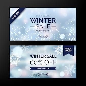 Banner di vendita inverno sfocato con fiocchi di neve