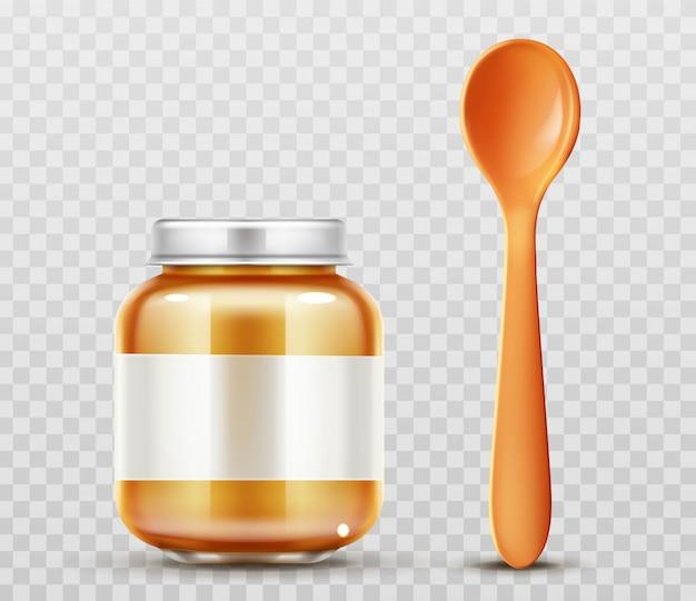 Barattolo per alimenti per bambini con un cucchiaio di vetro