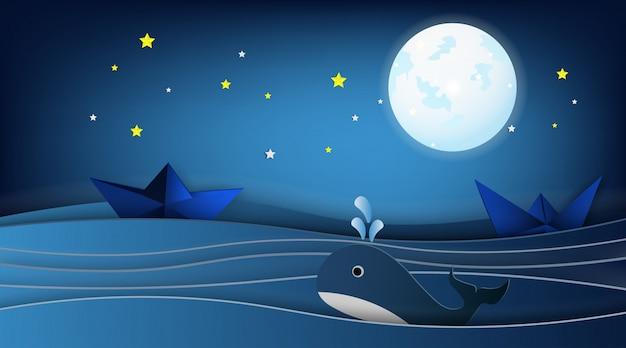 Barche a vela sul paesaggio dell'oceano con la balena.
