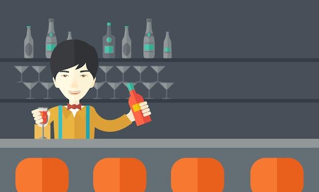 Barista al bar con un drink