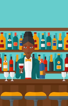 Barista in piedi al bancone del bar
