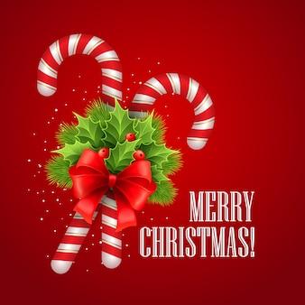 Bastoncino di zucchero di natale con agrifoglio e fiocco rosso, cartolina d'auguri.