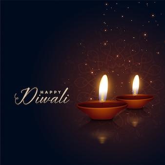 Bei due diya di festival di diwali su fondo scuro