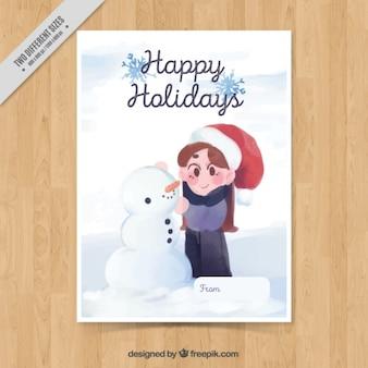Bella cartolina di natale con il ragazzo e pupazzo di neve