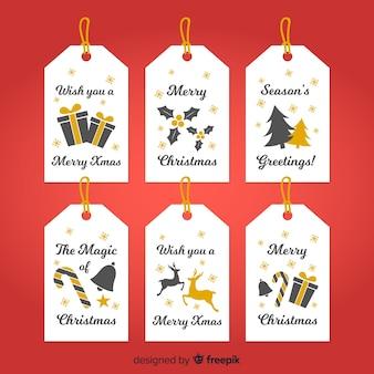 Bella collezione di etichette natalizie con design piatto
