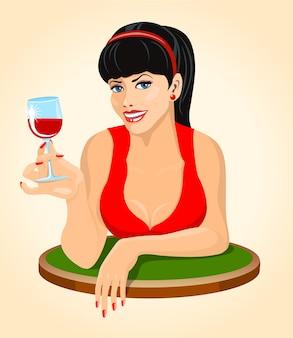Bella donna bruna in abito rosso con un bicchiere di vino