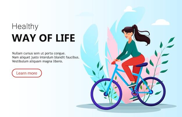 Bella donna in sella a una bicicletta
