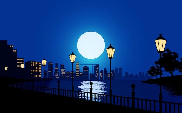 Bella notte in città con fiume e lampioni