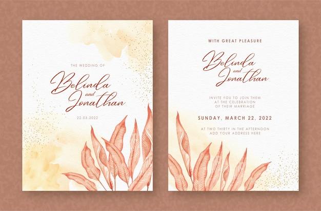 Bella partecipazione di nozze con foglie esotiche acquerello