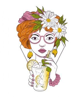 Bella ragazza con gli occhiali beve un cocktail