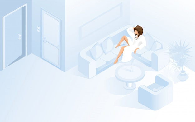 Bella signora in accappatoio bianco sul divano in hotel