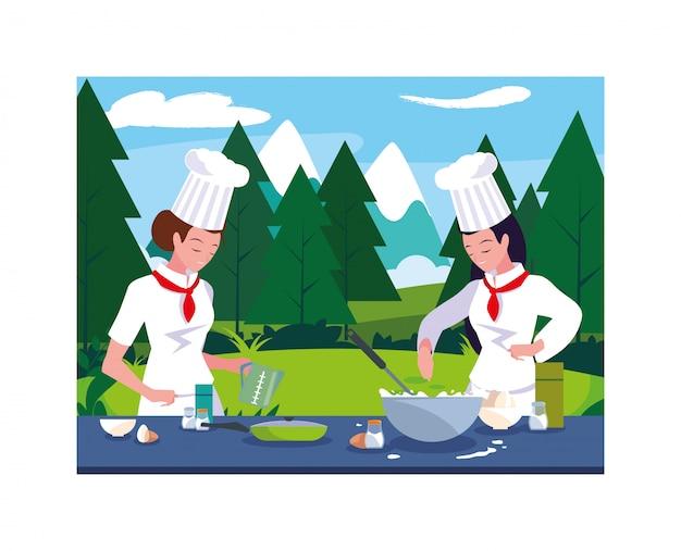 Belle donne in cucina, chef in uniforme bianca