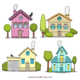 Belle facciate di case disegnate a mano con gli alberi