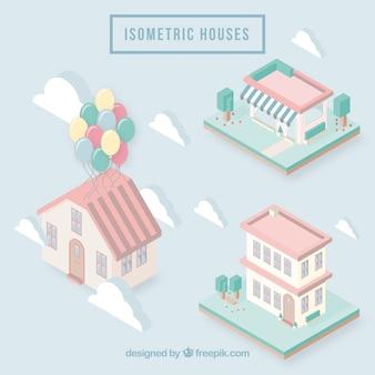 Belle facciate di case isometriche in toni pastello
