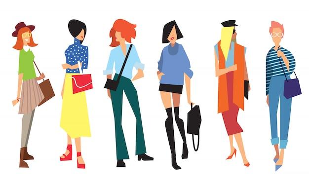 Belle giovani donne in abiti di moda