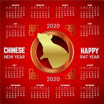 Bello calendario cinese rosso e dorato di nuovo anno