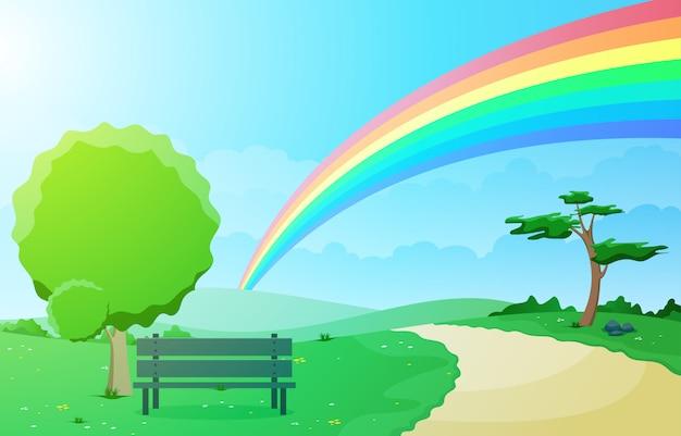 Bello cielo dell'arcobaleno con la natura verde della montagna del prato