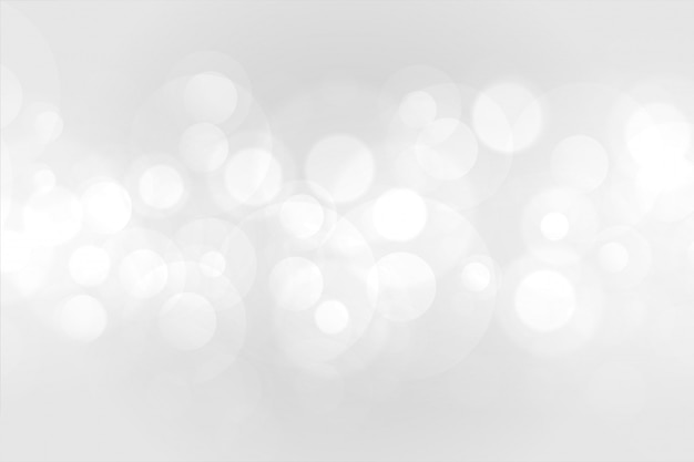 Bello fondo bianco di effetto delle luci del bokeh