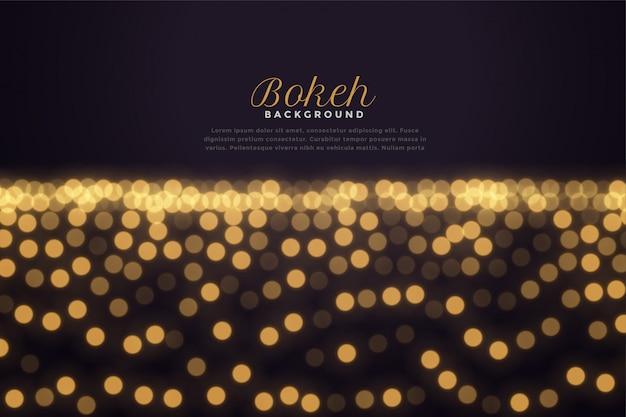 Bello fondo dorato di effetto della luce del bokeh