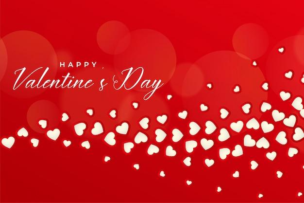 Bello fondo rosso di giorno di biglietti di s. valentino con i cuori di galleggiamento