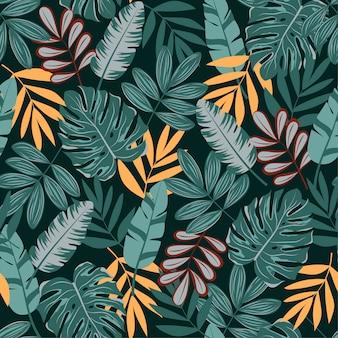 Bello modello senza cuciture con piante e foglie tropicali