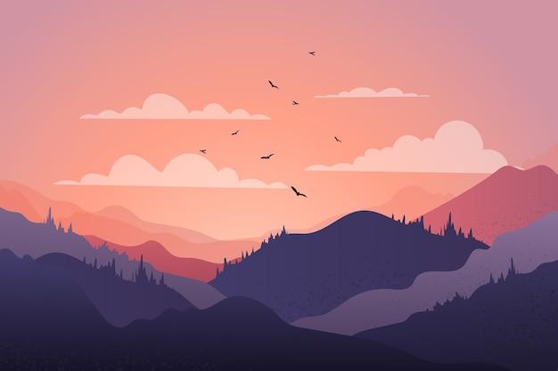 Bello paesaggio della catena montuosa al tramonto con gli uccelli