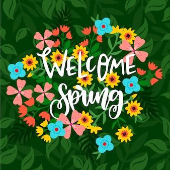 Benvenuti scritte di primavera con fiori colorati