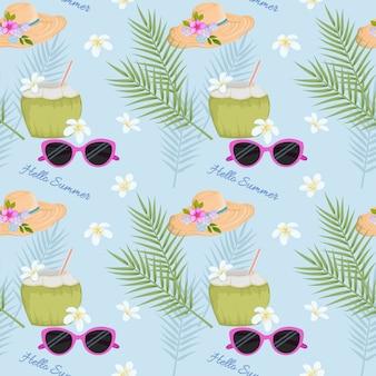 Bevanda estiva in cocco sulla spiaggia con motivo a cappello e occhiali da sole.