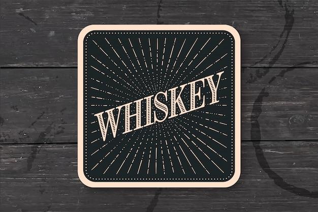 Bicchiere da sottobicchiere con scritta whisky