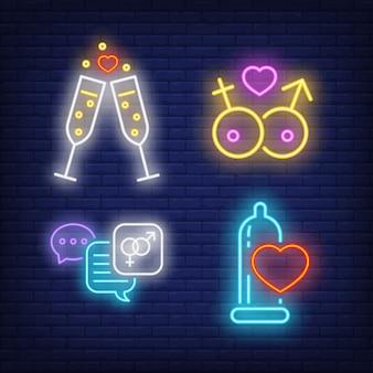 Bicchieri di champagne, fumetti e insegne al neon del preservativo