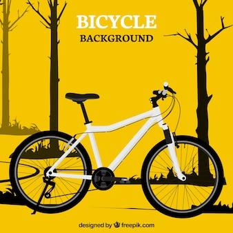 Bicicletta gialla e alberi sfondo