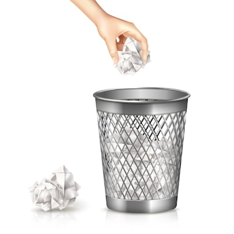 Bidone della spazzatura con mano e foglio di carta usato realistico