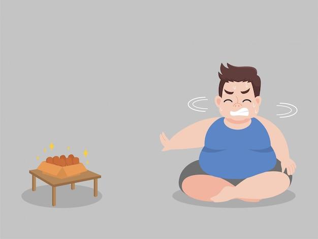 Big fat man affamato cerca di non mangiare la coscia di pollo
