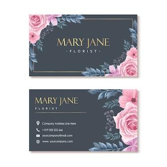 Biglietto da visita fiorista blu navy con cornice floreale dell'acquerello