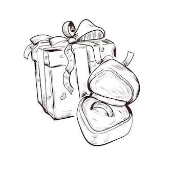 Biglietto di auguri con regalo presente in confezione natalizia, anello nuziale in scatola di velluto a forma di cuore.