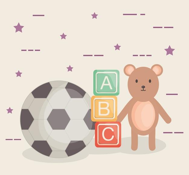Blocchi alfabetici con giocattoli per bambini