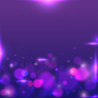 Bokeh brillante o sfocato sullo sfondo viola astratto.